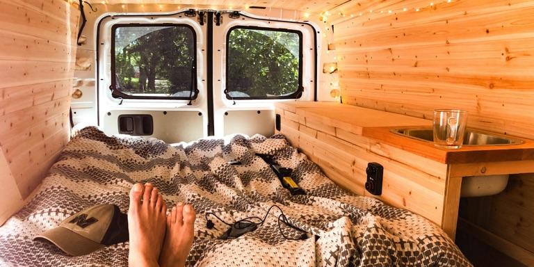 feet resting on van bed