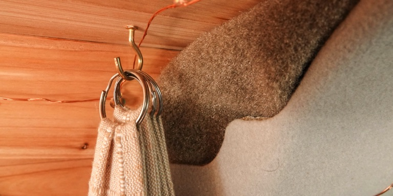 curtains being held up by key rings and hooks