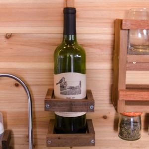 wine bottle placed in a rack