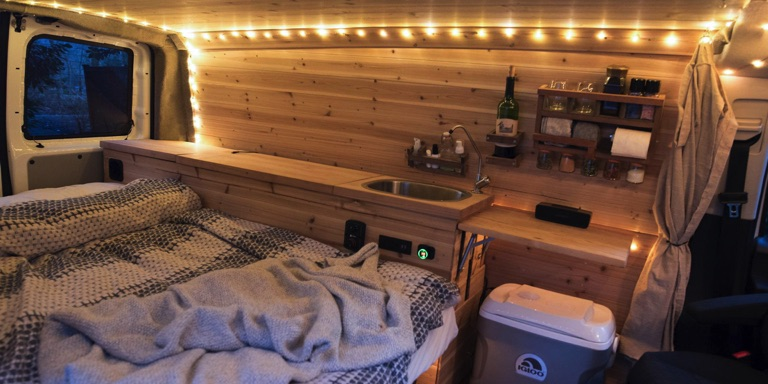 Interior of camper van at night with LED lights